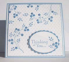 "By ladybug91743 at Splitcoaststampers. Stamp branch from ""Thoughts and Prayers"" (Stampin' Up) in blue ink on white cardstock panel. Repeat twice more. Dry emboss panel in ""Swiss Dots"" folder. Mat on blue then white then blue card base. Stamp sentiment and part of same branch in blue on white piece; die cut with oval die. Die cut oval scallop from blue to use as mat for sentiment. Pop up sentiment onto card."