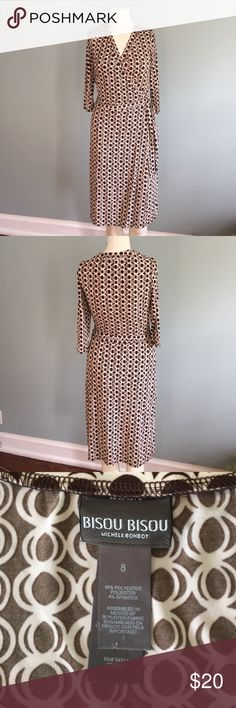 Bisou Bisou Brown & White Wraparound Dress Made from 96% polyester/4% spandex, this easy-care dress is flattering and comfortable. Bisou Bisou Dresses Long Sleeve