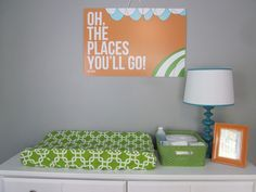 we have a teal blue wall and light gray carpet. This orange and green combo could be a perfect color scheme for a boy.