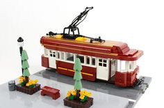 https://flic.kr/p/TgxKDW | Faithful Trolley | I've always liked the look of trolley cars (trams/streetcars), and because they are often red and often have rounded corners and roofs, I thought it would look great with the part.  I was happy with how low I was able to make the sides of the trolley while still being able to roll the trolley.  My 12th and final entry for the ABS Builder Challenge Season 1 Finale. The part was used in several places on the trolley: The curved portion in the…