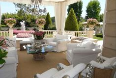 Lisa Vanderpump's porch- I love the white furniture, chandelier, and pink flowers @hookedonhouses.net
