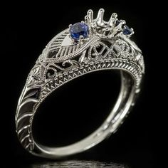 1920s style sapphire semi-mount engagement ring. This would make a stunning 3 stone cocktail ring with a diamond in the center setting! Love the filigree, milgrain and engraving vintage accents.