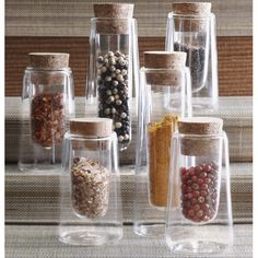 Reveal the beauty and colors of spices and seasonings in our Double-Wall Spice Jars. Crafted of borosilicate glass the jars are available in two sizes. The beautiful glass design, topped with cork stoppers create a visual treat. Buy Kitchen, Kitchen Pantry, Kitchen Dining, Kitchen Jars, Kitchen Storage, Kitchen Ideas, Spice Jar Set, Glass Spice Jars, Glass Bottles