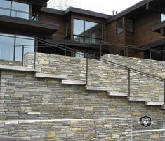 The Quarry Mill's Smokey Gold real thin stone veneer creates a beautiful outdoor living and stairwell on this modern style home. #naturalstoneveneer #realstoneveneer #thinstoneveneer #stonesiding #quarrymill #quarry #masonry #modernhome #beautifulhomes #dreamhome #newhome #welcomehome #designideas #designinspiration #outdoorliving #stonewall Real Stone Veneer, Natural Stone Veneer, Natural Stones, Modern Outdoor Living, Stone Siding, Modern Style Homes, Beautiful Homes, New Homes, Gold