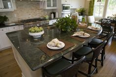 #Kitchen Idea of the Day: Gourmet Kitchen Island with beautiful green granite.