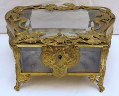 Art Nouveau box with tufted lining. Not beveled but so lovely it deserves to be shared.