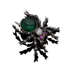 A gem-set spider brooch,