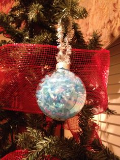Very easy child's  project for Christmas.  Took a clear iridescent Christmas ball from hobby lobby stuff with leftover blue Easter grass Tied a piece of leftover Silver tinsel ribbon to make A way to hang on tree. Great idea for children's Christmas gifts to friends and family