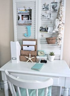 small space office. I like the shutter thing behind the table!