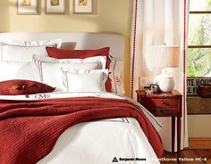 Bedroom with red quilt, white duvet and Benjamin Moore Hawthorne Yellow HC-4 walls - Pottery Barn