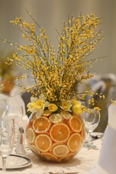 daffodils in flower arrangements | Table Flowers: Orange Slices with Genista and Daffodils