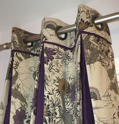 Grommet curtain with reinforced header trimmed with dark piping