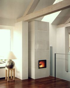 Tiled stove Lower Austria Existing tiled stove with large white glass . Tiled stove Lower Austria Existing tiled stove, which was clad with large shiny white tiles and Wood Stove Modern, Modern Fireplace, Fireplace Ideas, Stove Fireplace, White Tiles, New Homes, Living Room, Architecture, Furniture