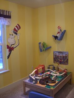 Seuss - love the Cat in the Hat by the window and the crooked bookshelves -- would be cute in my classroom!