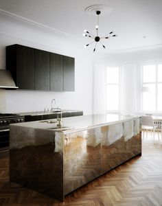 black kitchen cabinet and mirrored surface kitchen island. white walls and bright white ceiling.