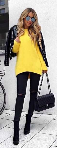 #spring #outfits Black Leather Jacket + Yellow Knit + Black Ripped Skinny Jeans + Black Booties