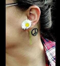 Peace Tattoo behind the ear....much smaller but love the concept