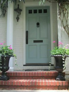 Love this front door color. The door color is Benjamin Moore Wythe Blue; door handle set is by Weslock; exterior paint color is unknown but is close to Benjamin Moore China White or Pratt and Lambert Gray Moire. Door Paint Colors, Front Door Colors, Paint Colors For Home, Exterior House Colors, Exterior Paint, Exterior Shutters, Cottage Exterior, Wythe Blue, House Of Turquoise