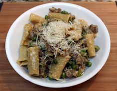 """Pasta with Italian Sausage & Peas in """"Cream"""" Sauce. I did this with gnocchi, a pound of sweet Italian sausage, romano instead of parm, and a mess of crushed red pepper on mine."""