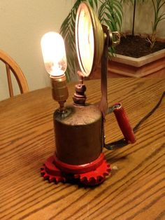 Steampunk Edison blowtorch spotlight lamp with iron cog feet. Edison lightbulb, vintage brass blowtorch, reclaimed iron cannery cogs.