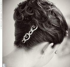 Two crystal-studded hairpins complemented the loose curls in Gina's classic French twist.