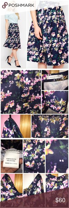"""Style London Midi Skirt in Floral Print Brand is Style London by ASOS. Bought off of ASOS. Never worn; just washed. Pleated skirt. All over floral print. Has a back zipper. 95% polyester and 5% elastane. Measurements: Waist is approx 30"""" and length is approx 27"""". ❌NO TRADES❌ ASOS Skirts Midi"""