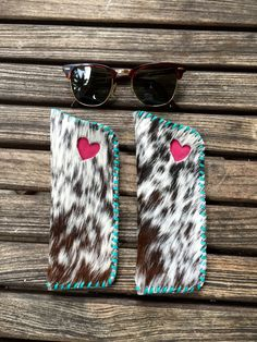 Cowhide eyeglass cases, stitched and lined in turquoise with pink suede turquoise hearts.  From gowestdesigns.us
