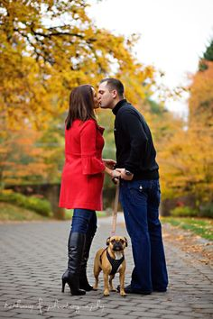 fall engagement pose photography with dog so cute...except I don't know if my cat would sit for it
