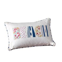 Cotton pillow with a goose feather down fill and patchwork beach design.       Product: Pillow  Construction Material: