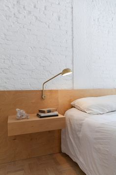 White bedroom with plywood headboard and bedside table. Ap Cobogó by Alan Chu. #minimalism