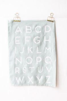 We love this super-easy tutorial for making faux-screen-printed alphabet tea towels. #DIY