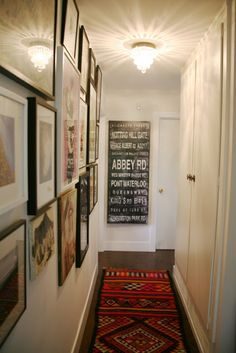 Amber Interiors - entrances/foyers - vintage, subway sign, art gallery, Chic, eclectic foyer design with vintage subway design and art gallery. Decor, Narrow Hallway, Apartment Life, Foyer Decorating, Amber Interiors, House Styles, Amber Interiors Shoppe, Apartment Decor, Home Deco