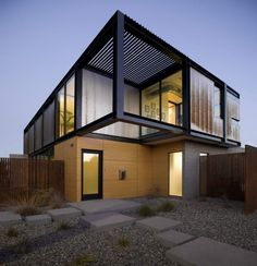 This fantastic house has been designed by the talented Chen+ Suchart studio architects which is sympathetic to its urban situation. The use of wooden cladding soften the design, perfectly complimenting the landscape.