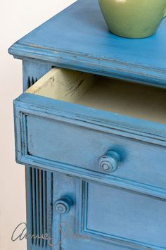 learn the basics of using chalk paint and soft wax from annie sloan, chalk paint, painted furniture, Annie used Old Ochre Chalk Paint for the inside of the drawer and Greek Blue on the outside of the cabinet She added Clear and Dark Soft Waxes Be sure to watch the video for distressing details