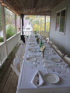 table set up: long table on wrap around porch