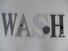 Wooden letters decorated with premium scrapbook paper and embellishments. Made by Deerlightful Decor