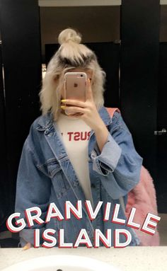 Oversized jacket, graphic tee, fluffy bag , princess updo with dangly bun