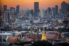 Wat Phra Kaew (Temple of the Emerald Buddha) in foreground of Bangkok's skyline.