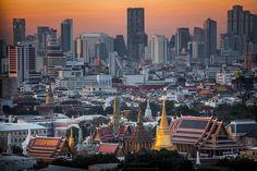 Wat Phra Kaew (Temple of the Emerald Buddha) in foreground of Bangkok's skyline.
