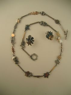 String of Curses Necklace, with Expletive Earrings, by Ahlene Welsh, 2004. Sterling silver and 14k gold.
