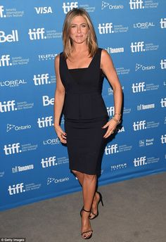 No surprises this time: Jennifer Aniston donned a more conservative LBD for a press confer...