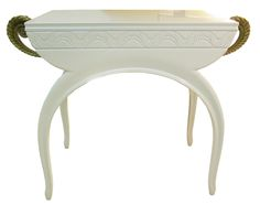 Armand-Albert Rateau (1882 - 1938) Vanity (circa 1925) A white lacquer table with arching legs, featuring a carved design along the apron and two drawers with scrolling gilt-bronze handles. Impressed twice on the table A.A. RATEAU Impressed on each handle A.A. RATEAU Height: 30 ¼ in (76.8 cm) Length: 40 ¼ in (102.2 cm) Depth: 18 ¼ in (46.3 cm)