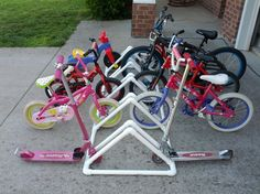 Pictures of amazing things that were made with PVC pipe. PVC pipe is a very cheap item to purchase at your local home improvement store. There are many things you can build using PVC pipe. To make things from PVC Pvc Bike Racks, Diy Bike Rack, Bicycle Rack, Bike Holder, Do It Yourself Organization, Garage Organization, Organization Ideas, Pvc Pipe Projects, Projects For Kids