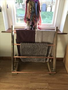 Upcycled a ladder and some copper pipe into a towel rack.