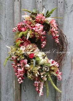 Fall Wreath, Autumn Wreath, Fall Floral Wreath, Victorian Wreath, Designer Pumpkin Wreath, Country French Wreath, Elegant Fall Wreath  Lenox Victorian Garden Wreath. Gorgeous and elegant hues of deep salmon pink, blush, ivory, sage and avocado green are showcased in this timeless treasure. Lush Cabbage Roses, Wisteria, Peonies, Tea Roses, wildflowers and meadow grass grace the edge of swirls of grapevine. Nestled among the lush blooms is a sweet 5 lightly gilded soft green pumpkin, adding a…