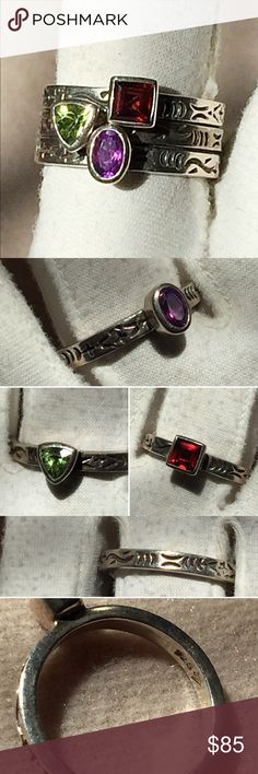 Retired Silpada 3 Pc. Stackable Sterling Ring Set Gorgeous retired Silpada Stackable ring trio.  Price is for all three and I will not separate.  Cool geometric bezel set genuine gemstones of Peridot, Amethyst and Garnet.  Large size 10 that will look awesome as thumb rings.  Two rings might fit a size 10.25. They also feature side engrave/etch detail.  Very good pre owned and loved condition Hi were could use a light cleaning.  Hard to find the trio and these also work great with other…