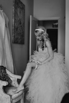 Don't forget this picture of the bride putting on her garter!