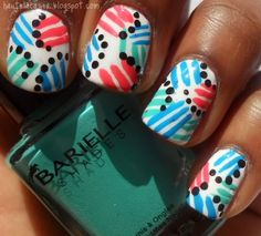 Simple angle lines with tops on their ends make up this easy to do nail art mani