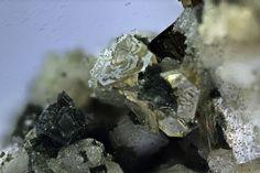 Daqingshanite, (Sr,Ca,Ba)3(Ce,La)(CO3)3-x(PO4)(OH,F) 2x, Mont Saint Hilaire, Québec, Canada. Yellowish, translucent crystal cluster of sharp tetrahedrons