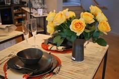 Candlelight garden roses in a Simon Pearce ceramic vase